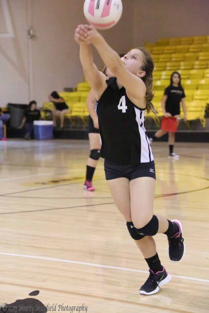 Montana Trujillo chases the ball and makes the pass during the C-team Game