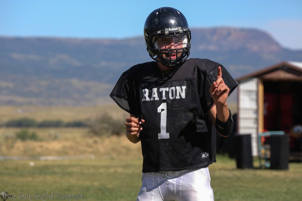 Quarterback Cam Baird looks for the play from coaches during practice Wednesday afternoon