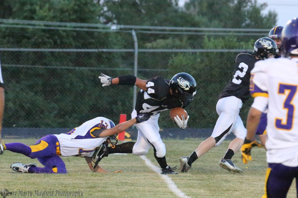 Anthony Saenz crosses the goal line for Raton's first TD of the evening