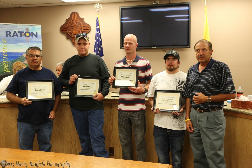 Mayor Bobby LeDoux recognizes these men for their efforts in saving a mother and her children from their car whic was caught in the rising waters of the North underpass.  L to R Dennis Decker, Seth Garcia, Eddie Lawrence, Matt Preston and Mayor Bobby LeDoux Not Pictured was Casey Redd