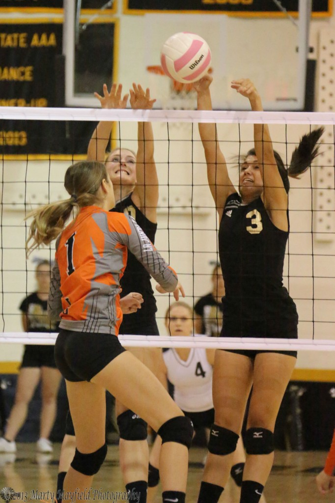 Makayla Vertovec and Shania Dorrance go for the block at the net during the first game of the match with La Junta