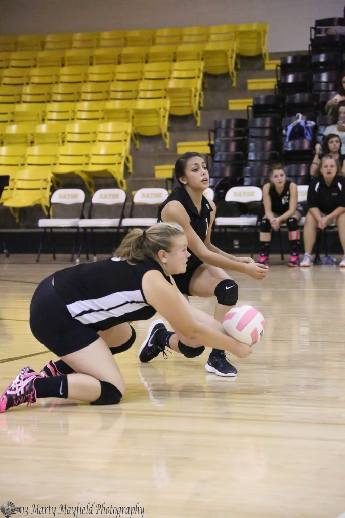 Heather Sandoval gets to the floor to keep the ball in play during the C-team game.