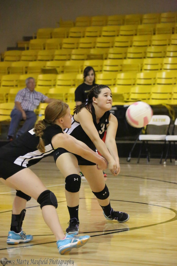 Christina Jaramillo and Alyssa Pais go for the ball during the JV game in Tiger Gym