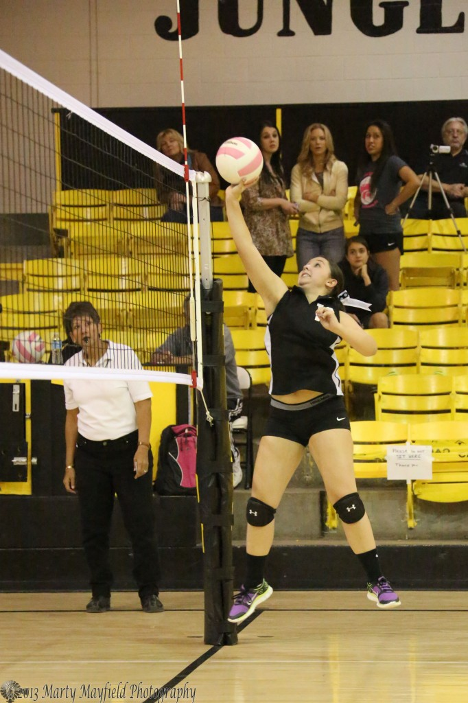 Sophia Madalini puts the ball over the net during the JV game Saturday afternoon against Taos