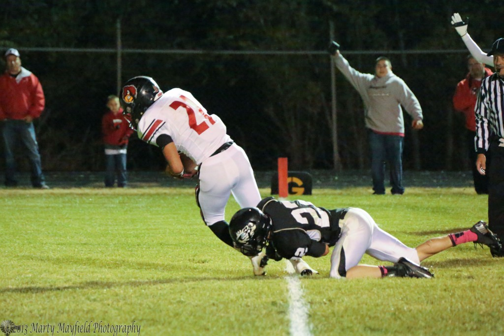 Caleb Wood tried in vain to stop Dominic Lucero as he falls into the end zone for another Robertson TD