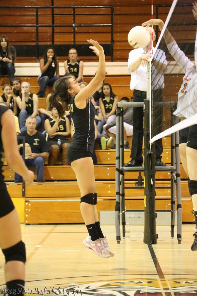 Montana Baker makes the tap back over the net as Kalista Dorrance just misses the ball Thursday evening in tiger Gym