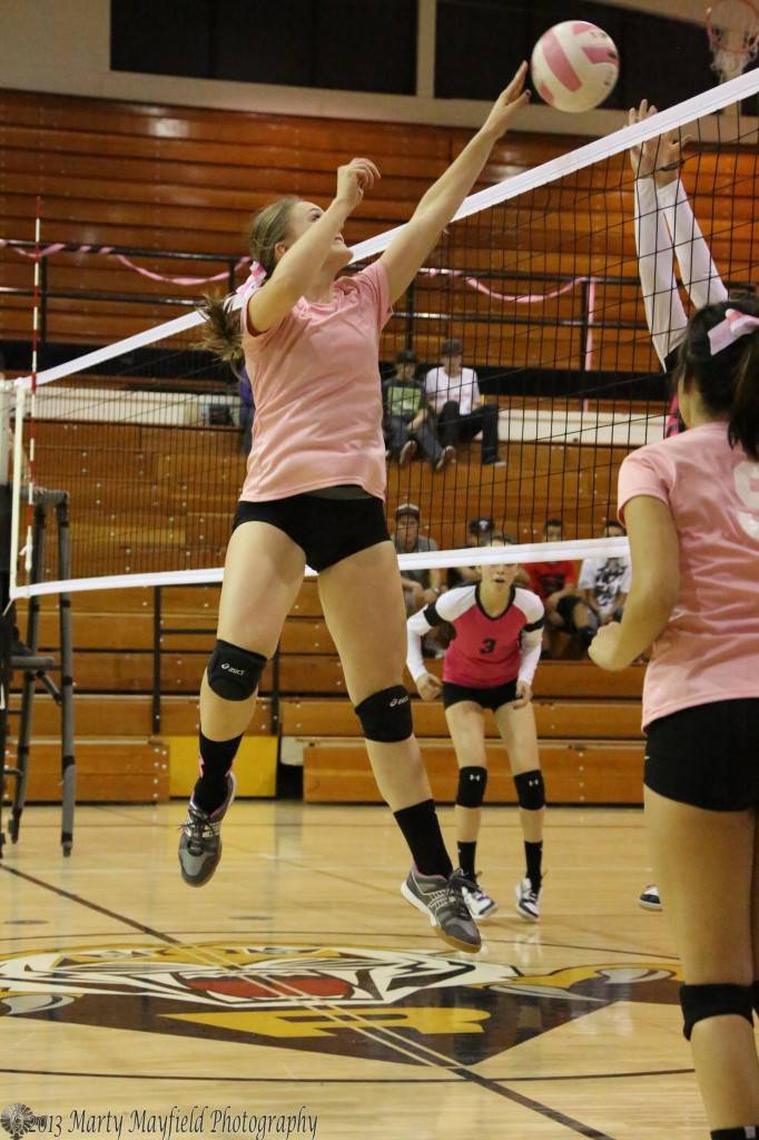 Mikala Vertovec gets up for the tip over the net during the varsity game against the Robertson Cardinals