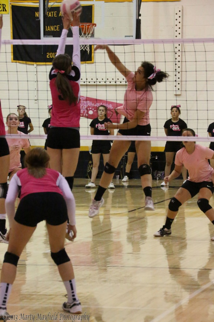 Robertson's Kimmeah Martinez goes for the block as one of the Dorrance twins makes the spike