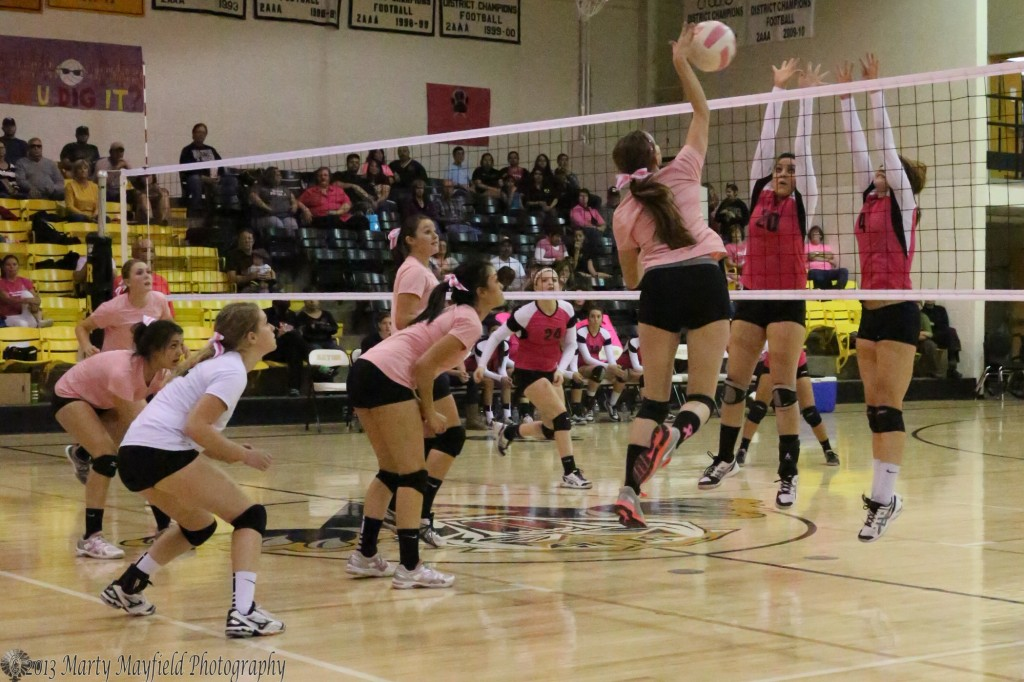 Leah Cimino goes for the kill as Robertson's Allison Martinez (20) and Abby Bradley (4) go for the block. The rest of the Lady Tigers move to the net to prepare if the block comes back over. Sarandon Walton, Kallista Dorrance, Mikala Vertovec, Ashley Nuerauter and Shania Dorrance.