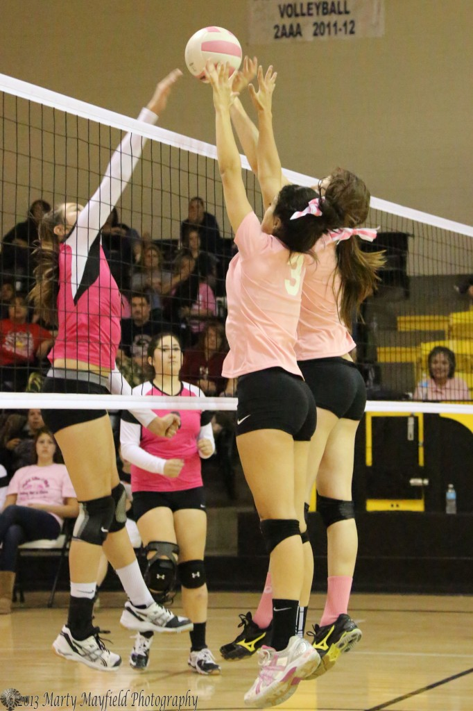 Shania Dorrance and Kristina Jansen get up for the block as Hannah Lopez tries to get just over their outstretched hands.