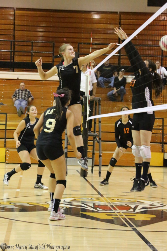 Mikala Vertovec gets the ball past Bertha Vigil as she went up for the block