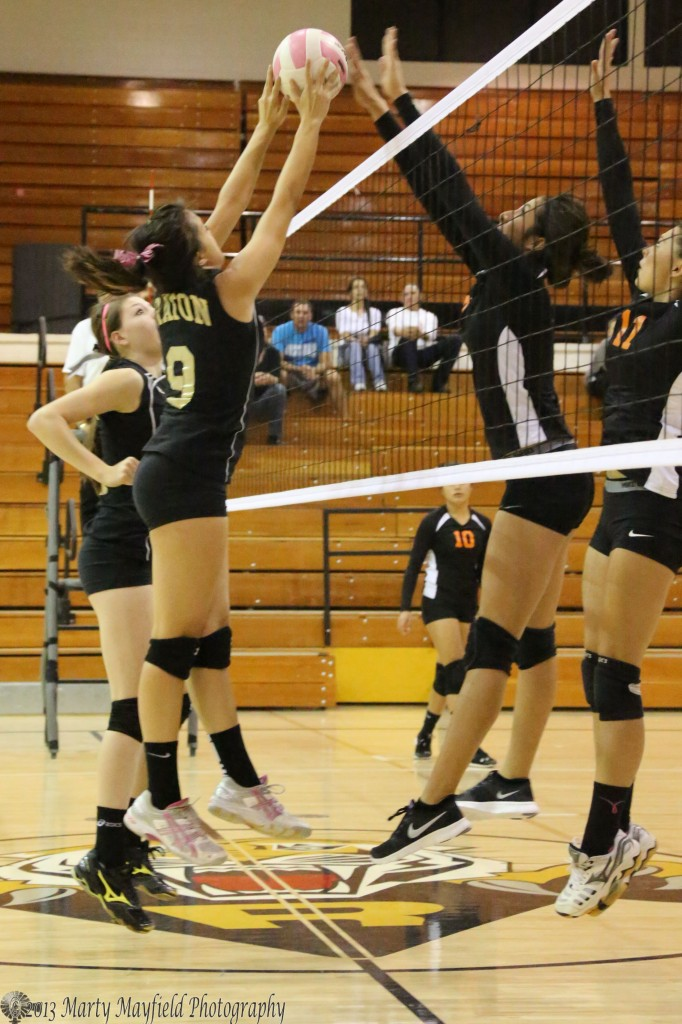 Kalista Dorrance makes the tip over the net as Deazia Cardenas goes for the block