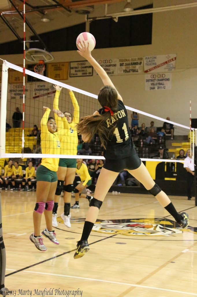 Kristina Jansen makes the hit over the net early in the match with West Las Vegas