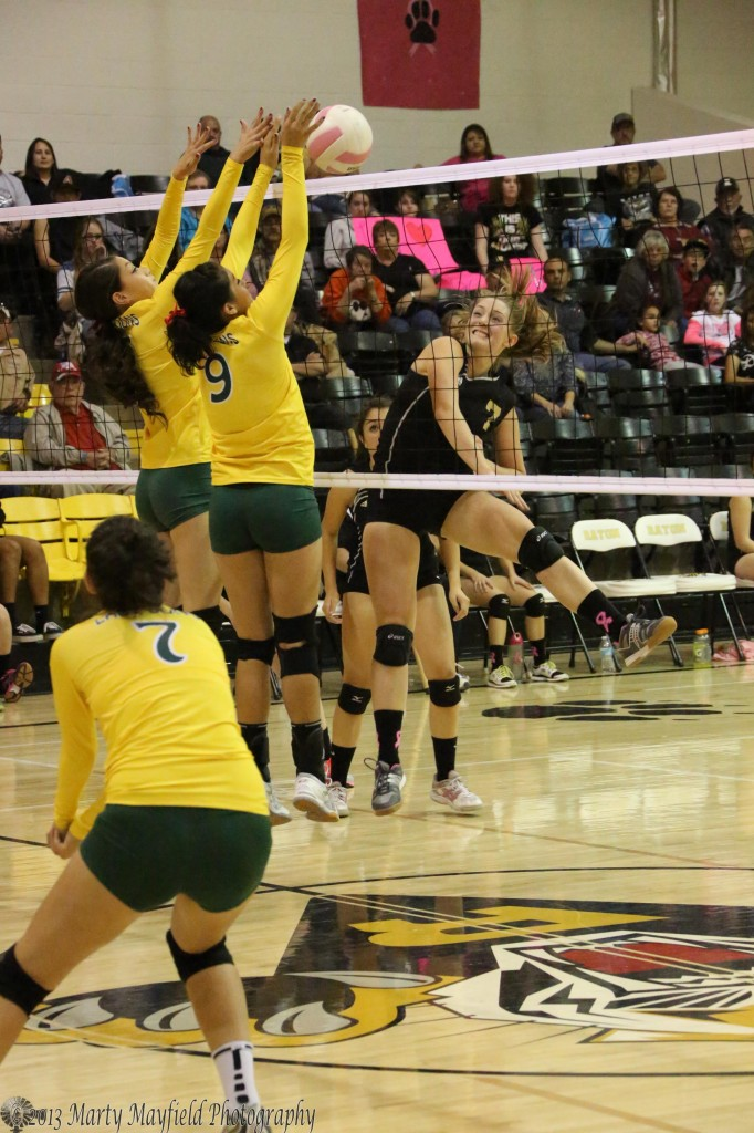 Celeste Trujillo(5) and Reyna Trujillo (9) go for the block on Mikala Vertovec's spike