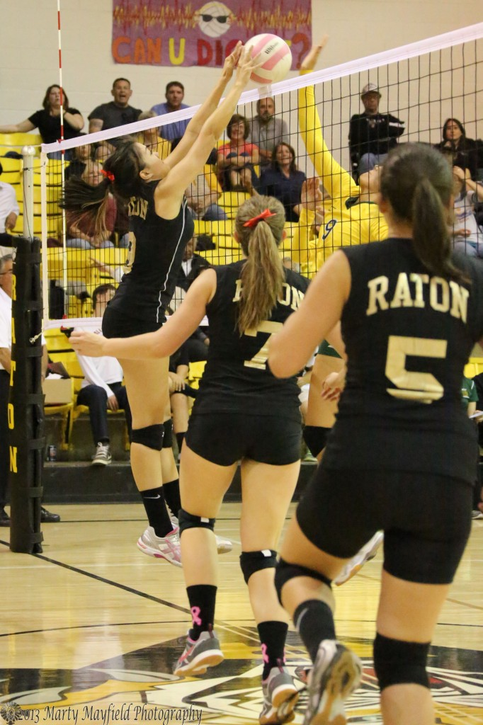Kalista Dorrance makes the block as Reyna Trujillo slaps the ball over the net a scene that played out several times during the match.