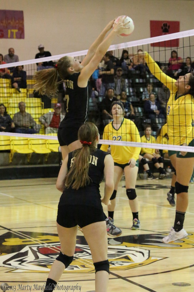 Mikala Vertovec makes the block as Reyna Trujillo slaps it over