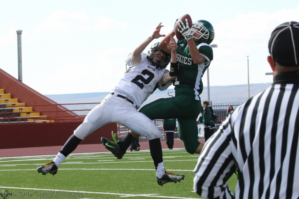 Andres Madrid manages to catch the ball despite the efforts of Toby Henson to break up the play during the state tourney game at Milne Stadium in Albuquerque.