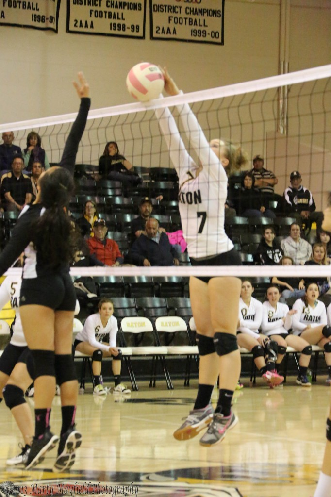 Mikala Vertovec makes the block at the net to make the point for Raton.