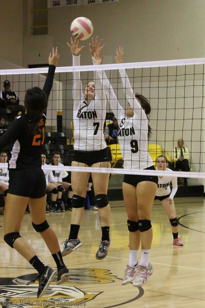 Taos Midnite Lujan tips it over as Mikala Vertovec and Kalista Dorrance move to block.
