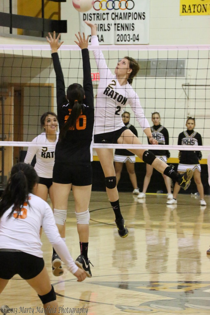Kristina Jansen sends it over the net as Bertha Vigil moves in for the block