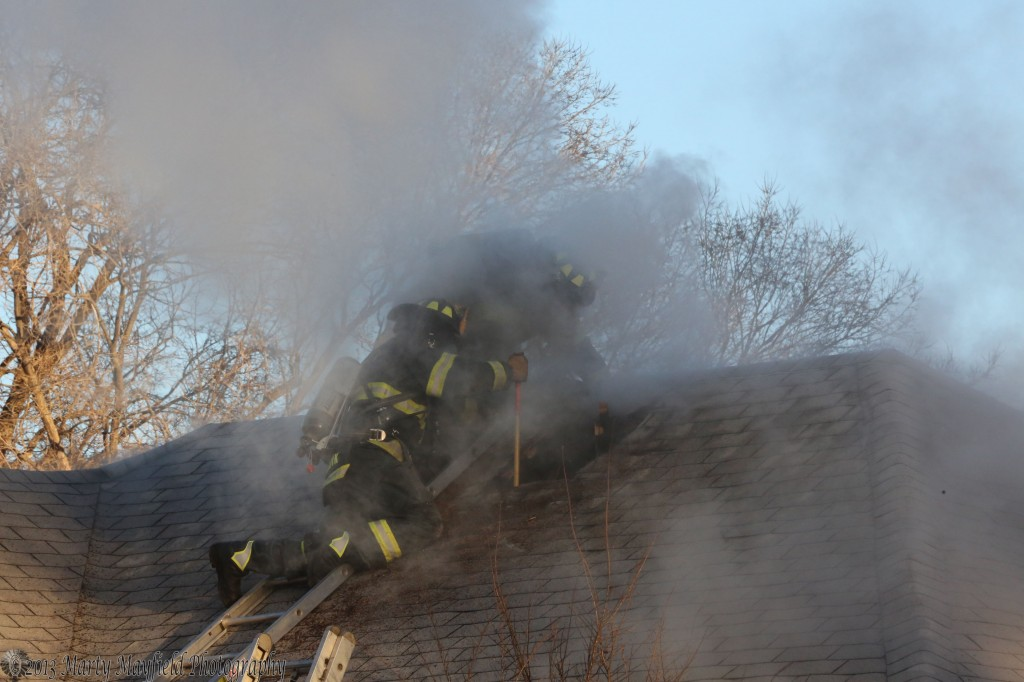 Fire Fighters exposed the attic to the home at 830 N 3rd and are probing inside Friday morning.