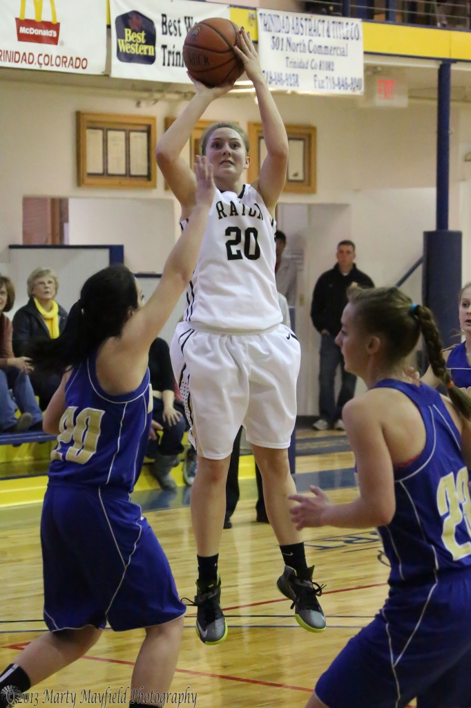 Mikala Vertovec takes the jumper Friday afternoon in Scott Gym for the Lady Tigers against Custer County
