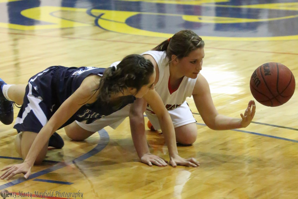 Trinidad's Cameron Gomez and Springer's Kyra Laumbach scramble for the ball during the girl's championship game Saturday evening in Scott Gym
