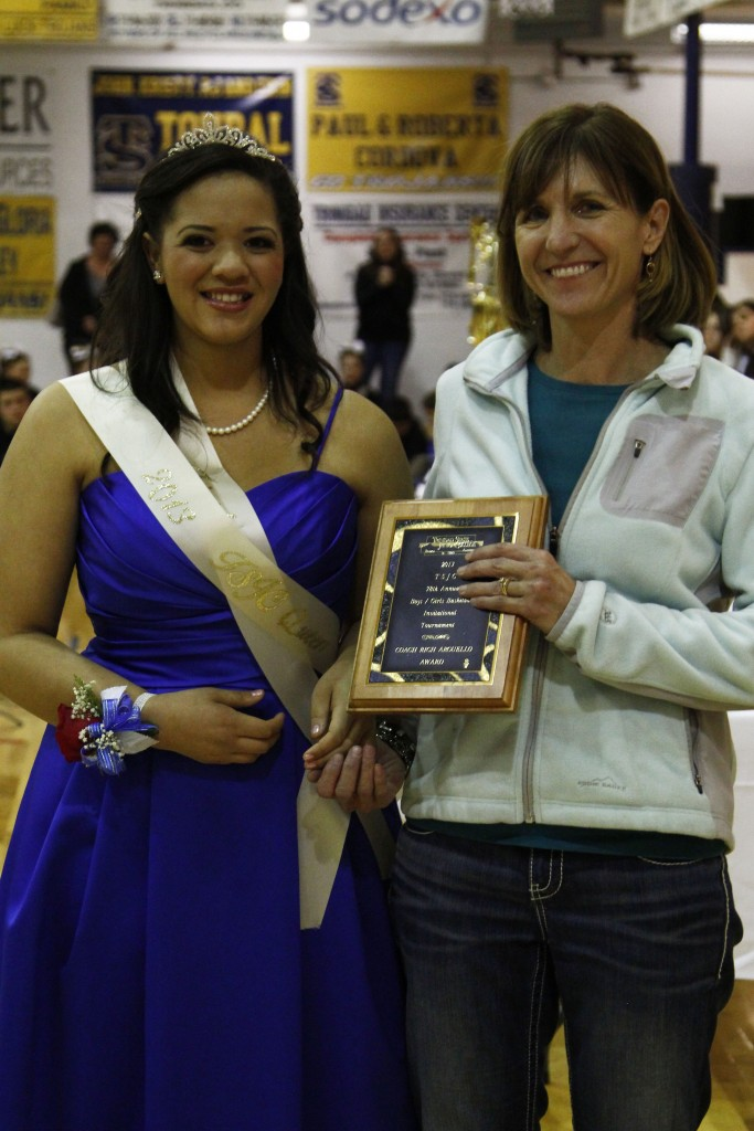 """Photos: (by Matt """"Moose"""" Young) Hoehne Coach Beth Kreutzer was presented the tournament coaching award by Queen Reyna Lujan"""