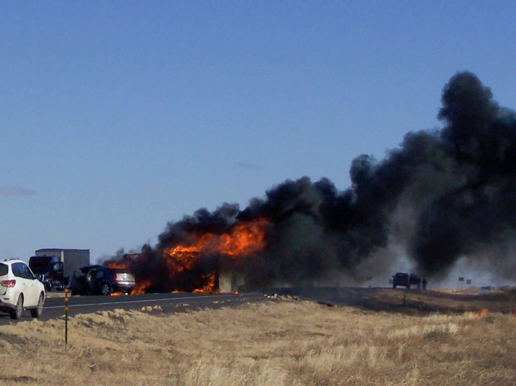 Photo by Mike Schoonover A bobtail truck is fully engulfed in flames just a few miles east of Des Moines on New Year's Day