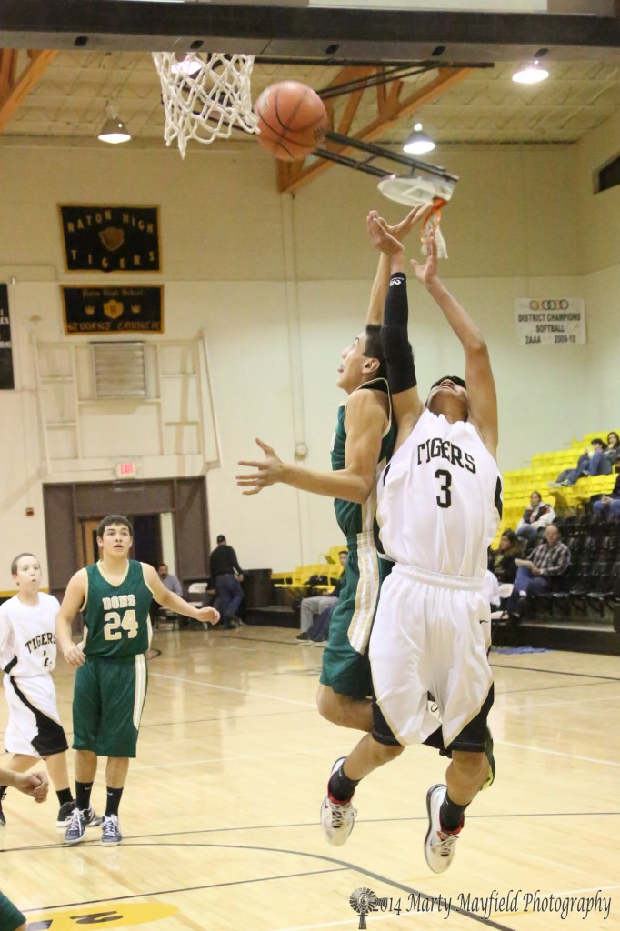 Jonathon Cabrieles goes up for the pass as S. Martinez gets in the way during the JV game Thursday night in Tiger Gym