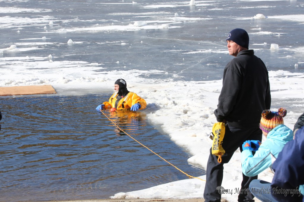 Raton Fire and Emergency Services personal as well as State Park's rangers for the first annual Polar Bear Plunge New Year's day at Lake Maloya