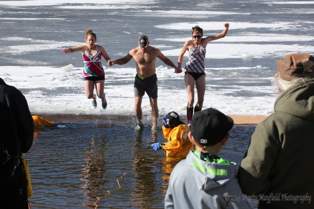 The first Polar Bears to make the plunge Wednesday afternoon at 34 degree Lake Maloya during the Polar Bear Plunge to raise money for a veteran's memorial near Legion Park.