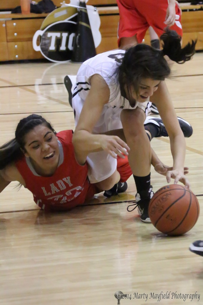 its a scramble for the ball as Erica Herrera (22) and Shania Dorrance go to the floor.