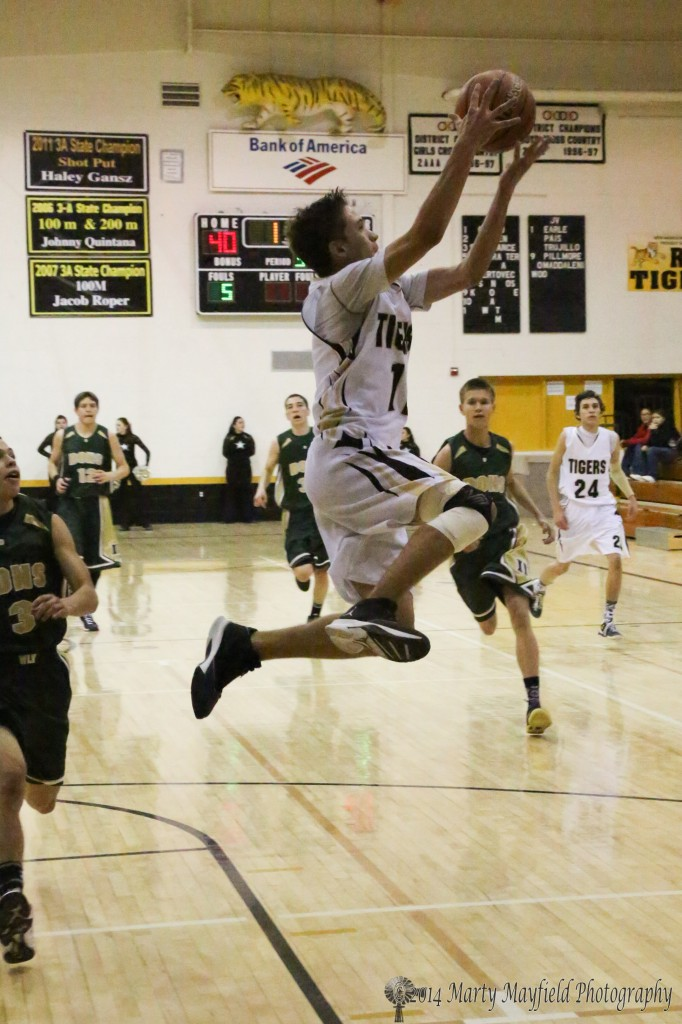 A high flying Kevin Fanelli reaches out for the high pass during the game in Tiger Gym Thursday evening
