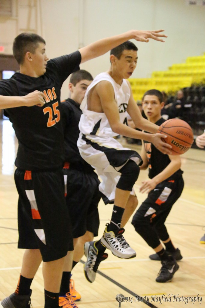 Jesse Espinoza gets air as he goes by Landon Archuleta on his way to the basket during the JV game Saturday evening in Tiger Gym