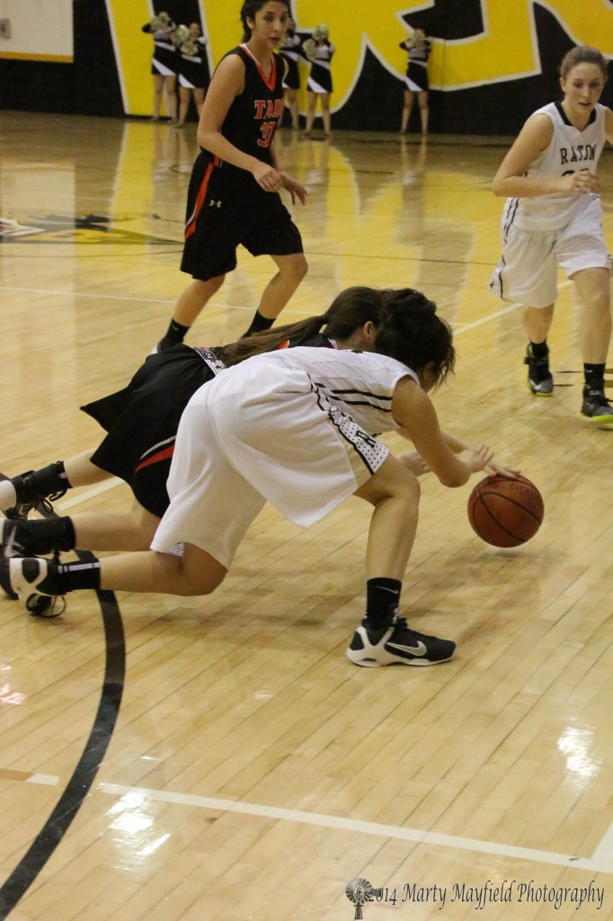 It was finally called a tie ball as the ladies scramble for a loose ball Friday night. Shania Dorrance and Deazia Cardenas were the two in scramble for the ball.