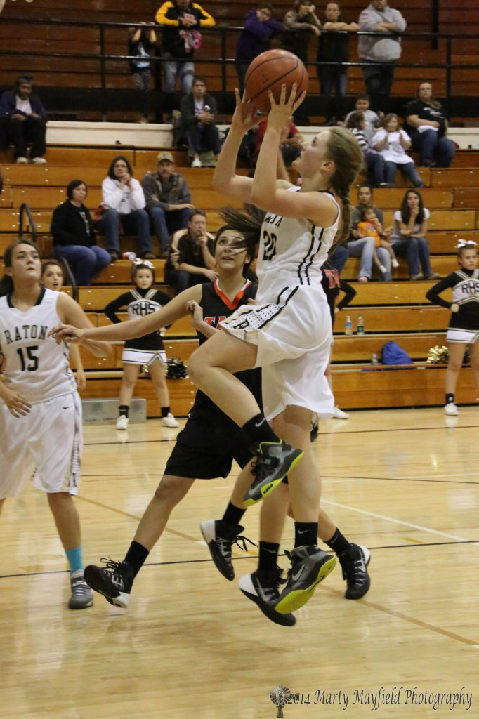 Mikala Vertovec drives the lane Friday night late in the varsity game.