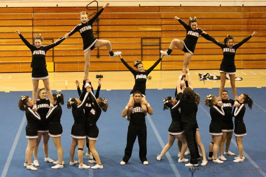 The RHS Cheer Team performs their state Spirit Competition routine at Tiger Gym Tuesday night in front of an enthusiastic crowd.
