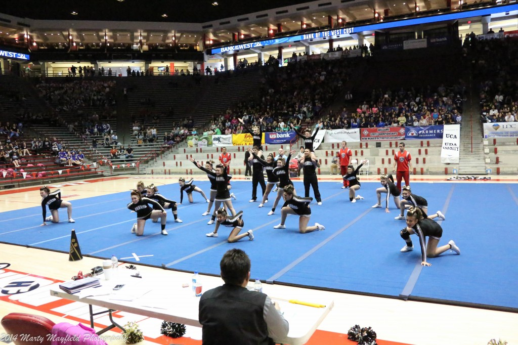 The girls finish their routine Saturday at the State Spirit Competition