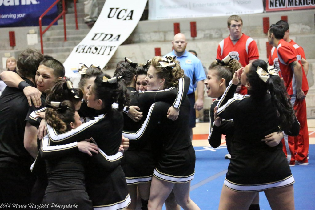 The girls celebrate after an almost flawless routine Saturday morning in the Pit