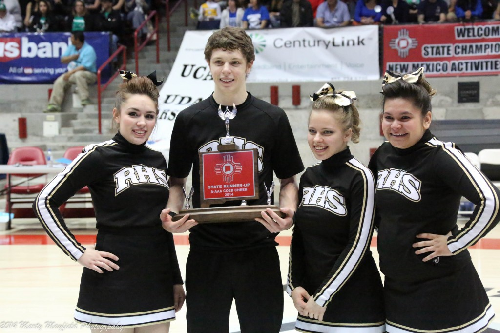 Jessica Haynes, Toby Henson, Cody Stone and Rachel Sanchez accept the second place trophy for their efforts at the State Spirit Competition at the Pit in Albuquerque Saturday morning.
