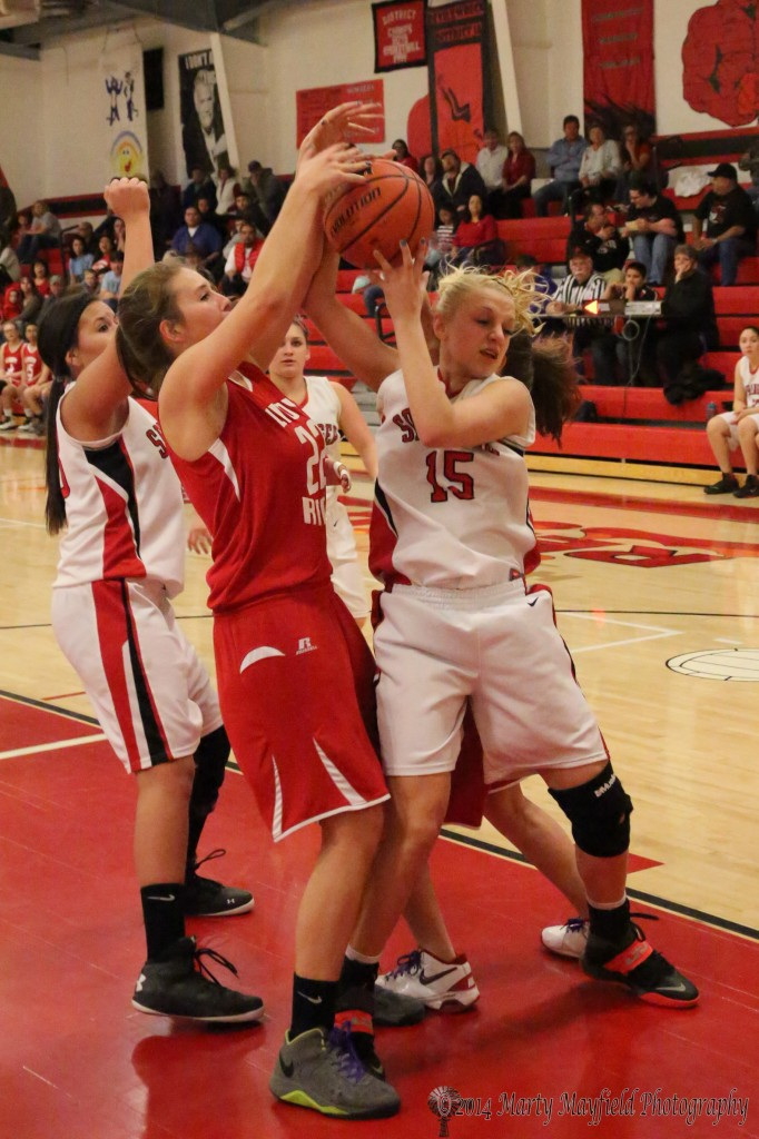 Gentry Haukabo and Danielle Blake (15) scramble for the rebound Friday night in Springer