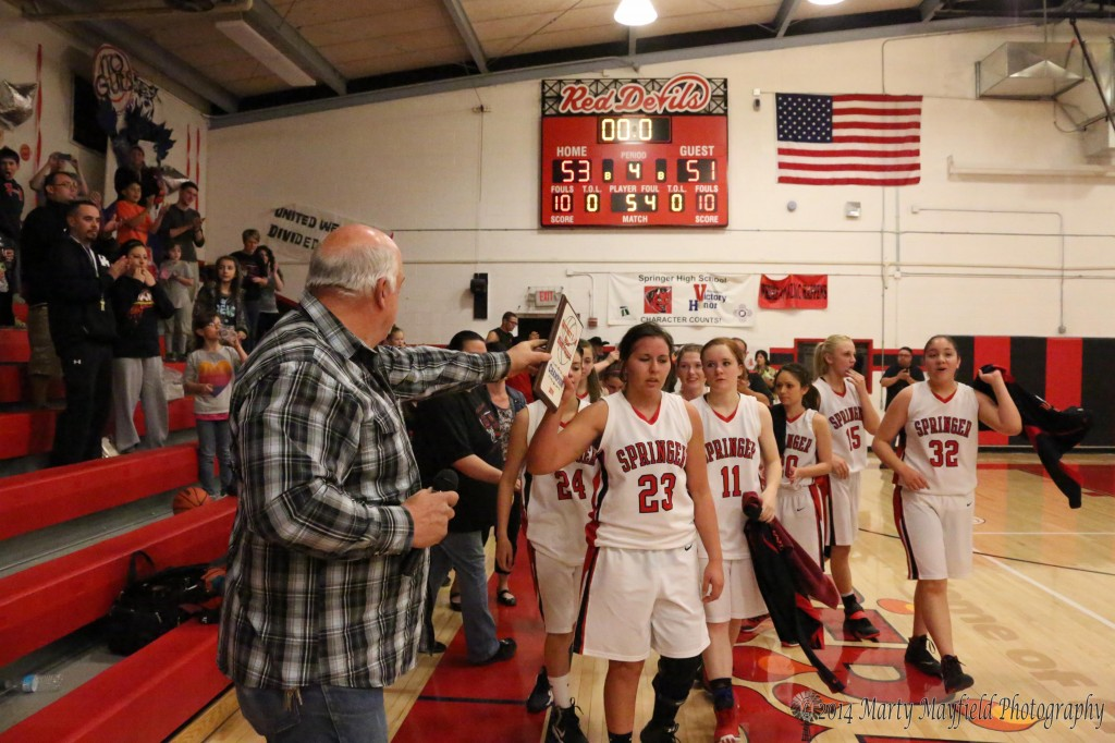The scoreboard shows the final score but in no way does it show how physical and competitive this district championship game really was Friday night in Springer as the Lady Red Devils Cordy Tafoya accepts the first place plaque from Mike Glasman