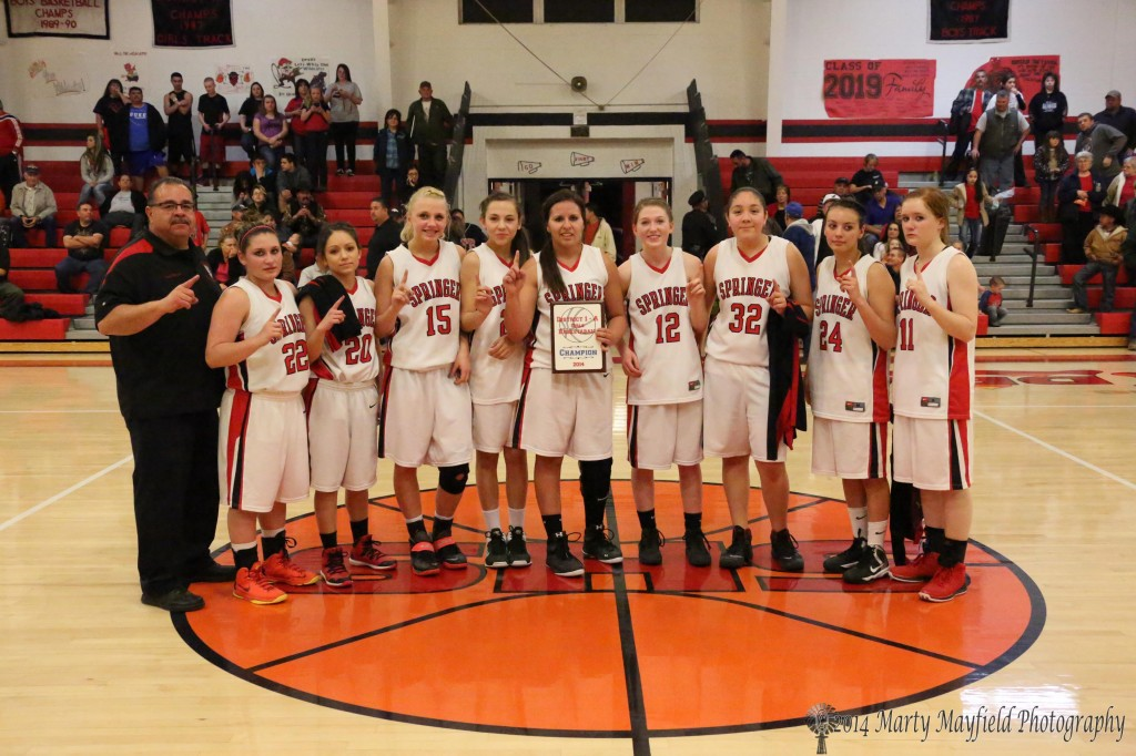 The Springer Lady Red Devils, District 1A champions for the second year in a row. Coach Thomas Ybarra, Kyra Laumbach, Angelica Quezada, Danielle Blake, Hannah Burton, Cordy Tafoya, Kara Burton, Alicia Arias, Angelica Montoya, Kylie Daugherty