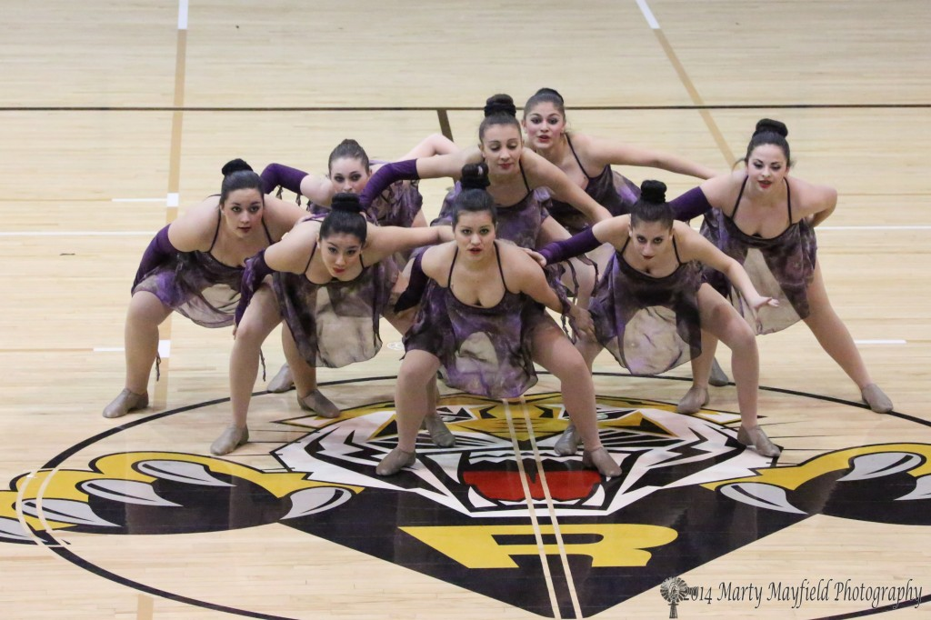 The Tiger Cats Dance Team performs their dance routine, which will be their routine for Saturday at the State Spirit Competition in the Pit in Albuquerque