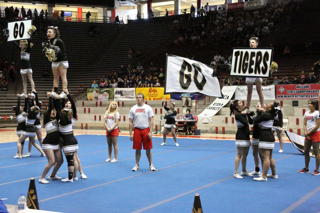 The RHS cheer team performs as a co-ed team this year at the Pit. It's the first time for Raton to compete as a Co-ed team