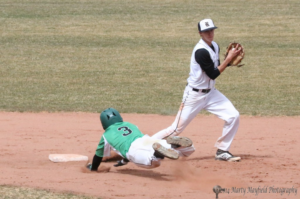 Rafael De La Torre III makes a flying leap for second but Ethan Washburn had already made the forced out at second and prepares to make the throw to first.
