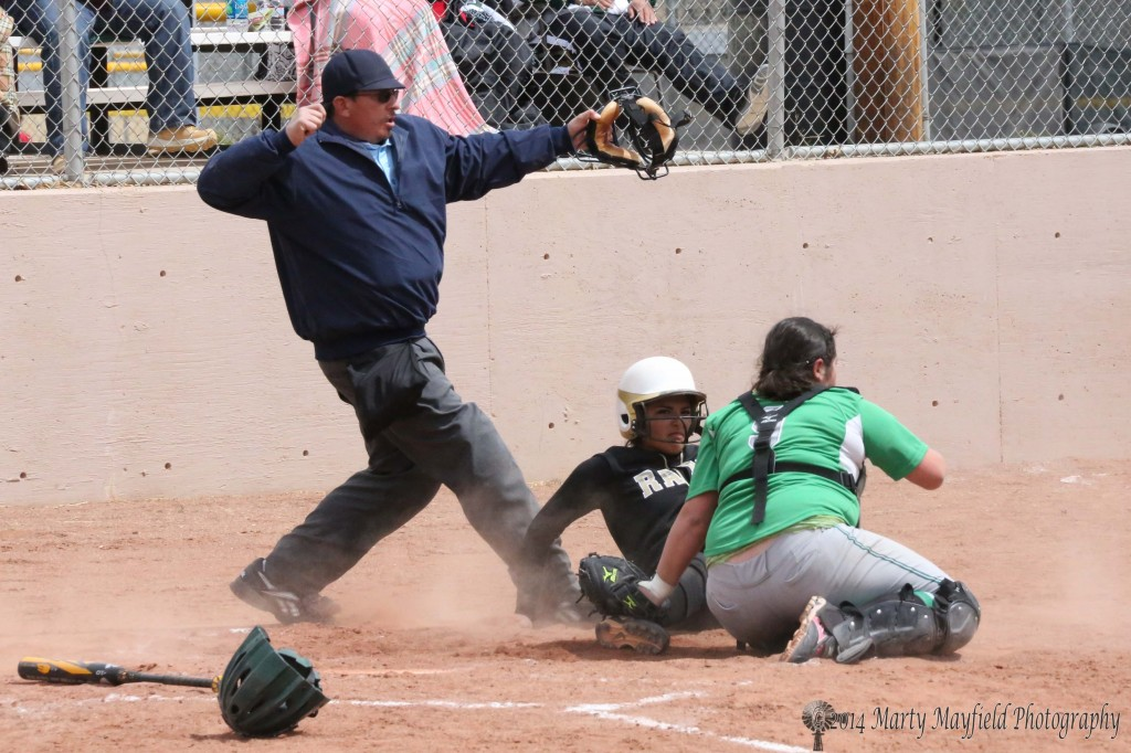 Natasha Archuleta is called out at home plate as catcher Analisa Martinez makes the tag
