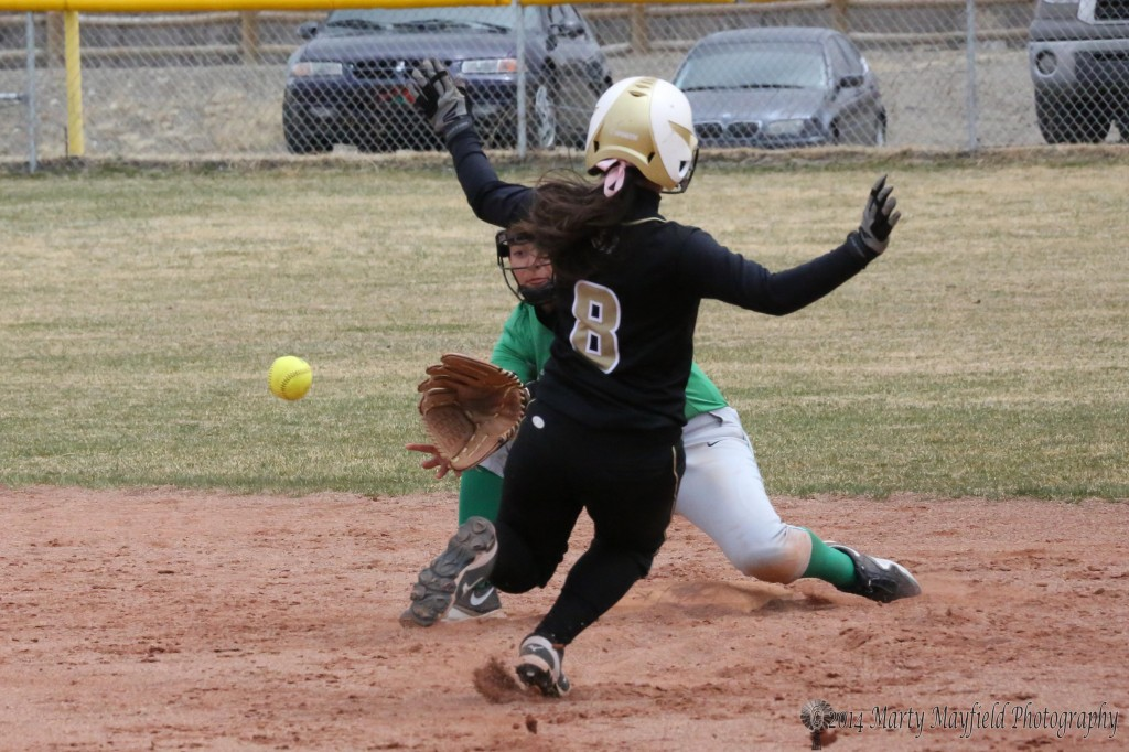 Late in game one Caydence Sisneros makes the slide into second base is she out or safe?