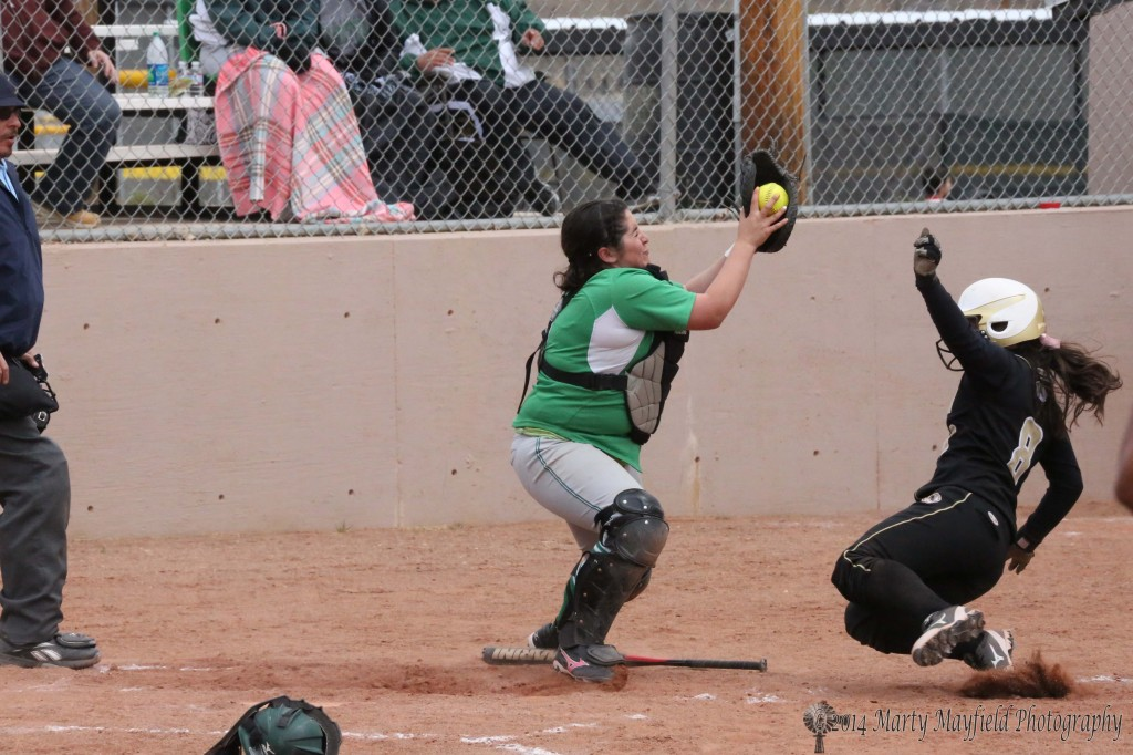 Once again Caydence Sisneros is making the slide, this time at home plate after her slide into second earlier on this series.